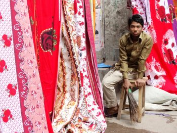 """Young Man at Fabric Stall"" Old City, Dhaka, Bangladesh"