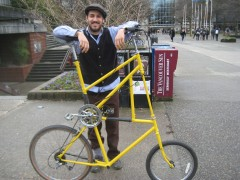 "Rahi outside the UBC Bike Kitchen. He rides a custom-built ""tall bike."""