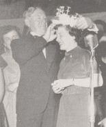 1953-54 UBC President MacKenzie crowning one of the year's queens. (AMS Archives)