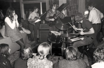 1968-69 It's a party, man. A band plays an unscheduled set during the Faculty Club occupation. (UBC Archives)