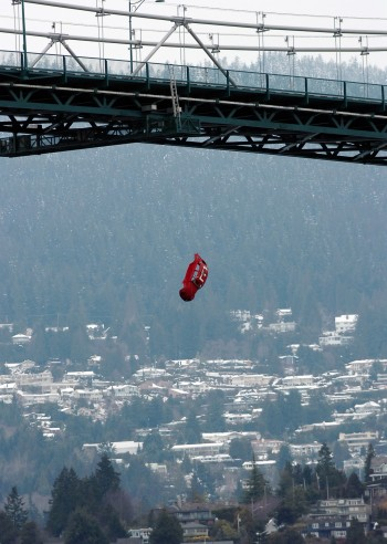 A Bug hangs from Lions Gate Bridge. Photo: Jason Payne/Province