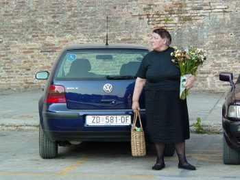 Woman with Flowers on Street (Croatia)
