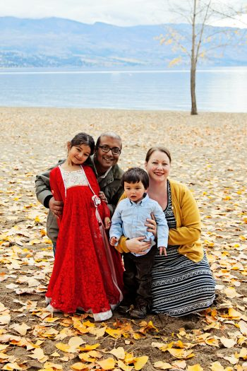 """Gibson and Ghosh with their children. """"Even my kids call me the Poop Lady,"""" laughs Gibson."""