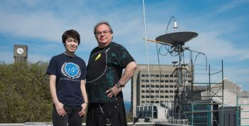Matthews with student Michelle Kunimoto in front of the communications antenna for Canada's first space telescope, on the roof of the Hennings Building at UBC. (Photo: Martin Dee)