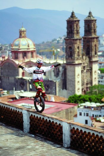 Holm riding along a wall in Mexico.