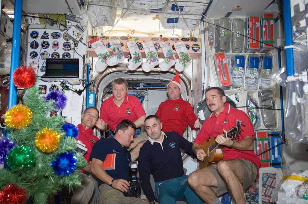 Expedition 34 crew members assemble in the Unity node of the International Space Station for a brief celebration of the Christmas holiday. The CSA's Chris Hadfield (R) is pictured with Russian cosmonauts and NASA astronauts. Image credit: NASA