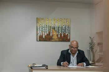 Dr. Ganesan in his office at the Chakra Health Centre. (Photo: Martin Dee.)