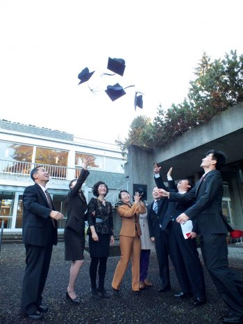 North Korean scholars celebrate with Professor Park on the day of their graduation ceremony.