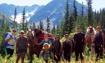 Skubovius (second from R) leads students and pack horses on the first Tene Mehodihi hike between Iskut and Telegraph Creek.