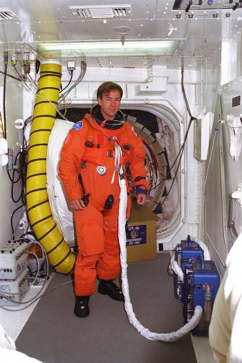 Canadian astronaut Tryggvason prepares to enter the Space Shuttle orbiter Discovery during a practice exercise for launch day. Image credit: NASA