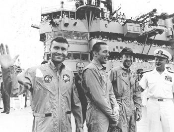 Apollo 13 astronauts Fred Haise, John Swigert, and James Lovell aboard the recovery ship USS Iwo Jima after safely touching down in the Pacific Ocean at the end of their ill-fated mission. The mission was aborted after 56 hours of flight, 205,000 miles from Earth, when an oxygen tank in the service module exploded. Image credit: NASA