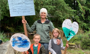 Tara Martin with her kids during the climate strike in September 2019.