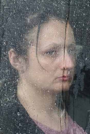 """Woman in Rain‑Streaked Bus Window"" Odessa, Ukraine"