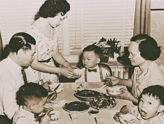 The Lee family sitting down for dinner. Albert Lee, Saint Mary's University, Gorsebrook Research Institute, GRI_134 (1958)